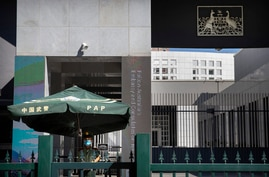 A Chinese paramilitary policeman stands guard at the Australian Embassy in Beijing, Tuesday, Sept. 1, 2020. Australia's…