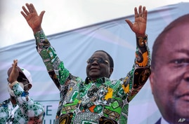 Former president Henri Konan Bedie, 86, gestures to supporters at a party rally to celebrate his presidential candidacy for the…