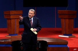 FILE - This Oct. 3, 2012 file photo shows moderator Jim Lehrer addressing the audience before the first presidential debate at…