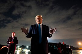 President Donald Trump talks with reporters at Andrews Air Force Base after attending a campaign rally in Latrobe, Pa.,…