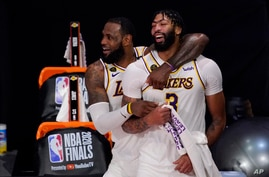 Los Angeles Lakers' LeBron James (23) and Anthony Davis (3) celebrate after the Lakers defeated the Miami Heat 103-88 in Game 6…