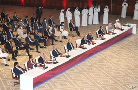 Abdullah Abdullah, center, chairman of Afghanistan's High Council for National Reconciliation, talks at the opening session of…