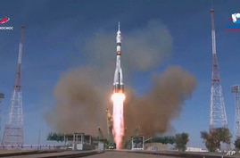 In this image made from video footage released by Roscosmos Space Agency, the Soyuz-2.1a rocket booster with Soyuz MS-17 space…