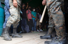 Honduras migrants stand in an army truck before returning home, in Morales, Guatemala, Saturday, Oct. 3, 2020. Early Saturday,…