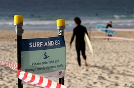 A sign tells surfers to leave once they have finished surfing at Bondi Beach in Sydney, Tuesday, April 28, 2020, as coronavirus…