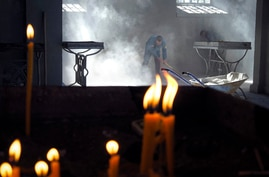 Church workers sweep the dust in the Holy Savior Cathedral, damaged by shelling by Azerbaijan's artillery during a military…