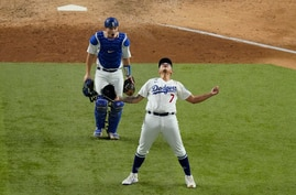 Los Angeles Dodgers starting pitcher Julio Urias celebrates their win against the Atlanta Braves in Game 7 of a baseball…