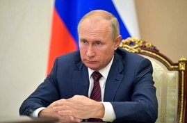 Russian President Vladimir Putin attends a meeting via video conference in Moscow, Russia, Thursday, Nov. 5, 2020. (Alexei…