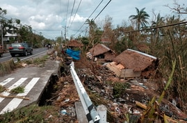 Houses destroyed by Typhoon Goni lie along the side of road in Albay province, central Philippines on Tuesday Nov. 3, 2020…