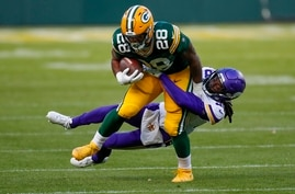 Minnesota Vikings' Harrison Hand stops Green Bay Packers' A.J. Dillon during the second half of an NFL football game Sunday,…