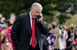 In this Oct. 30, 2020, photoWhite House chief of staff Mark Meadows speaks on a phone on the South Lawn of the White House in…