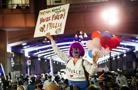 Demonstrators supporting a full ballot count gather outside the Philadelphia Convention Center three days after the…
