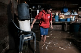 A woman walks into her house, flooded during the passage of Hurricane Iota in Siuna, Nicaragua, Tuesday, Nov. 17, 2020…