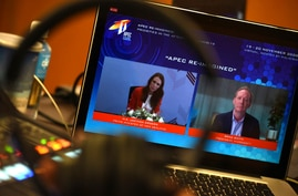 In this photo released by Malaysia Department of Information, a screen shows New Zealand's Prime Minister Jacinda Ardern, left,…