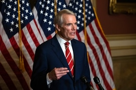FILE - This Monday, Oct. 26, 2020, file photo shows Sen. Rob Portman, R-Ohio, speaking during a news conference in Washington…