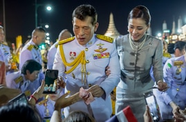 King Maha Vajiralongkorn and Queen Suthida greet supporters in Bangkok, Thailand, Sunday, Nov. 1, 2020. Under increasing…