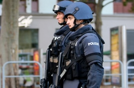 After a shooting armed police officers patrol on a street at the scene in Vienna, Austria, Tuesday, Nov. 3, 2020. Police in the…