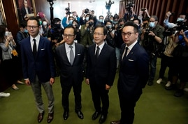 Four lawmakers, from left, Dennis Kwok, Kenneth Leung, Kwok Ka-ki and Alvin Yeung pose after a press conference at the…