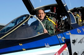 Japanese Prime Minister Yoshihide Suga sits on the cockpit of an F-4EJ Kai fighter jet of Japan's Air Self-Defense Force after…