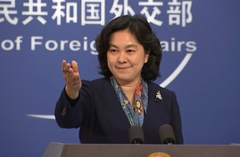 China's Foreign Ministry spokesperson Hua Chunying gestures during a press conference held at the Foreign Ministry in Beijing…