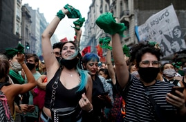 Abortion-rights activists celebrate as Argentine lower house approves a bill that would legalize abortion outside Congress in…