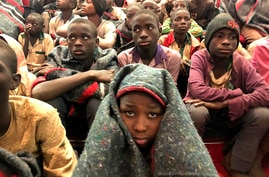 A group of schoolboys are pictured on Friday Dec. 18, 2020 in Katsina, Nigeria following their release after they were…