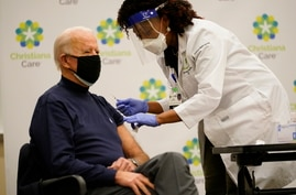 President-elect Joe Biden receives his first dose of the coronavirus vaccine at ChristianaCare Christiana Hospital in Newark,…
