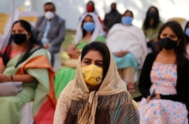 Faithful wearing face masks and maintain social distancing as a precaution against the coronavirus attend a Christmas mass at a…