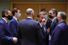 French President Emmanuel Macron, center, speaks with Hungary's Prime Minister Viktor Orban, right, during a round table…