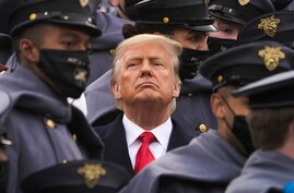 Surrounded by Army cadets, President Donald Trump watches the first half of the 121st Army-Navy Football Game in Michie Stadium…