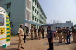 Police officers investigate the scene after a fire broke out at District General Hospital in Bhandara, about 70 kilometres from…