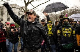 Protesters confront riot police as they gathered at the Capitol on Wednesday, Jan. 6, 2021 in Salem, Ore. Thousands of…