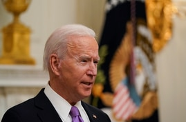 President Joe Biden speaks about the coronavirus in the State Dinning Room of the White House, Thursday, Jan. 21, 2021, in…