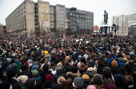 People gather in Pushkin Square during a protest against the jailing of opposition leader Alexei Navalny in Moscow, Russia,…