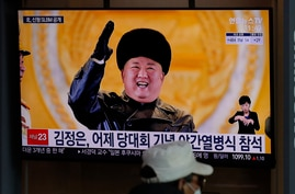 A man wearing a face mask sits in front of a TV screen showing North Korean leader Kim Jong Un, at the Seoul Railway Station in…