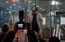 Mike Lam King-nam, who participated in the pro-democracy primary elections, walks out at a police station after being bailed…