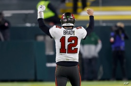 Tampa Bay Buccaneers quarterback Tom Brady reacts after winning the NFC championship NFL football game against the Green Bay…