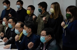 Pro-democratic party members shout slogans in response to the mass arrests during a press conference in Hong Kong Wednesday,…