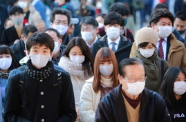 People wearing face masks to protect against the spread of the coronavirus visit Kanda Myojin Shrine on the first business day…