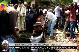 FILE - In this Thursday, July 2, 2020 file image taken from OBN video, the coffin carrying Ethiopian singer Hachalu Hundessa is…