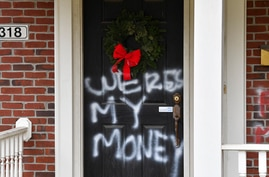 """Graffiti reading, """"Where's my money"""" is seen on a door of the home of Senate Majority Leader Mitch McConnell, R-Ky., in…"""