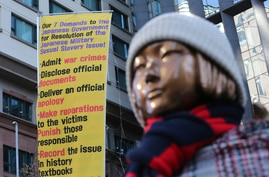 A statue symbolizing a wartime sex slave is displayed near the Japanese Embassy in Seoul, South Korea, Friday, Jan. 8, 2021. A…