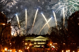 Fireworks light up the sky around the White House, Wednesday night, Jan. 20, 2021, in Washington, as part of the festivities…