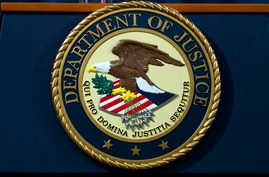 FILE - In this Nov. 28, 2018, file photo, the Department of Justice seal is seen in Washington, D.C. An internet firm is ending…