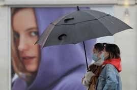 People wear masks to protect against coronavirus as they pass a shop in London, Wednesday, Feb. 3, 2021. Britain's Health…