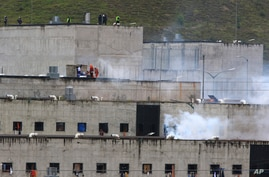 Tear gas rises from parts of Turi jail where an inmate riot broke out in Cuenca, Ecuador, Tuesday, Feb. 23, 2021. Deadly riots…