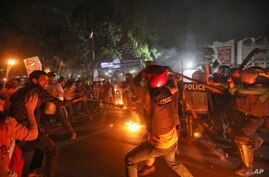 Demonstrators clash with police as they protest the death in prison of a writer who was arrested on charges of violating the…