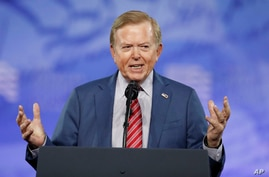 FILE - Lou Dobbs, with Fox News, speaks at the Conservative Political Action Conference (CPAC), on Feb. 24, 2017, in Oxon Hill,…