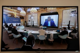 Democratic Republic of the Congo's President Felix Tshisekedi speaks during a video conference at the One Planet Summit, at the…