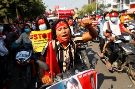 Anti-coup protesters join a rally on motorcycles in Mandalay, Myanmar, Saturday, Feb. 13, 2021. Mass street demonstrations in…